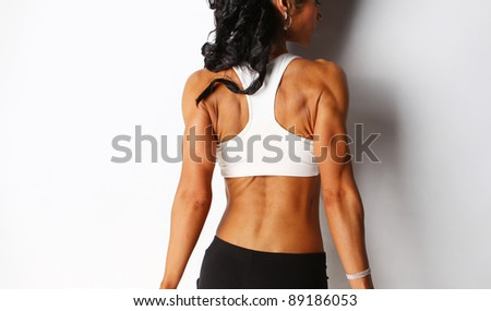 Image of female posing with dumbbells