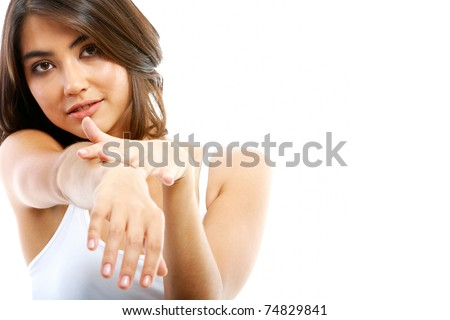 Image of female touching her manicured hand and looking at camera - stock photo