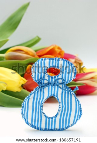 Image of figure 8 and colorful tulips, close-up - stock photo