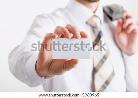 Image of fingers holding a blank business card