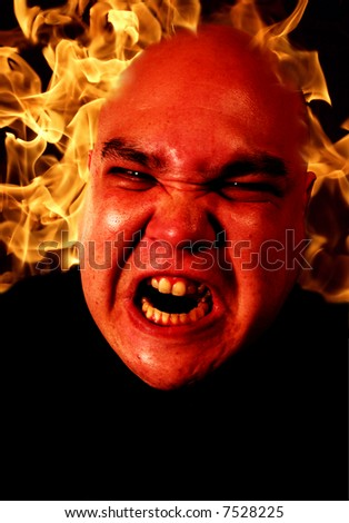 Image of fire and a demonic man.  Two files merged together and enhanced. Flame image is from my portfolio. - stock photo