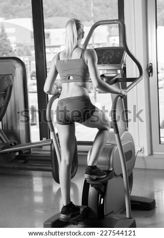 Image of fitness girl running on treadmill - stock photo