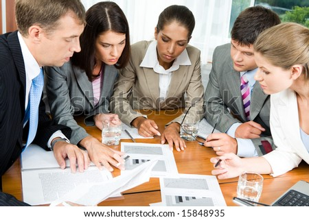 Image of five people looking at business-plan and brainstorming - stock photo
