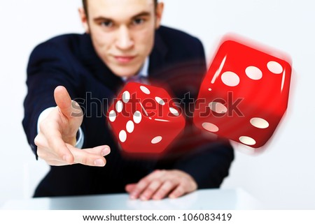 Image of flying dices as symbol of risk and luck - stock photo