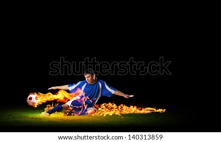 Image of football player in blue shirt - stock photo