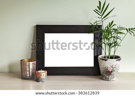 Image of frame mockup scene with plant and candle holders.  - stock photo