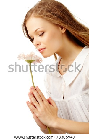 Image of fresh female holding nice herbera and smelling it - stock photo