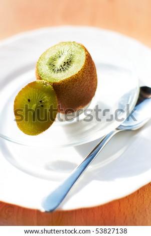 Image of fresh kiwi cut in glassy vase - stock photo