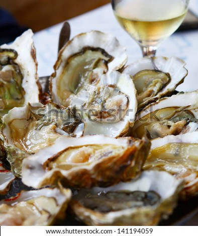 Image of fresh oysters with lemon close up - stock photo