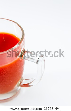 Image of fresh tomato juice close up isolated.