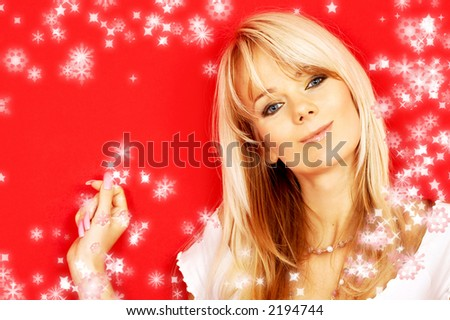 image of friendly blond over red background with rendered snowflakes - stock photo