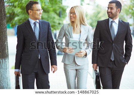 Image of friendly business team with two confident men and a lovely lady - stock photo