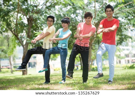 Image of friends doing a gangnam style dance - stock photo
