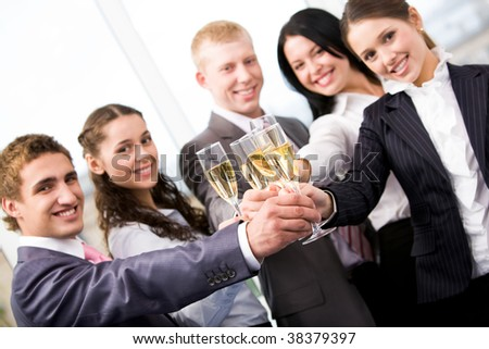 Image of friends making cheers and looking at camera - stock photo