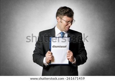 Image of frustrated business man who is fired - stock photo