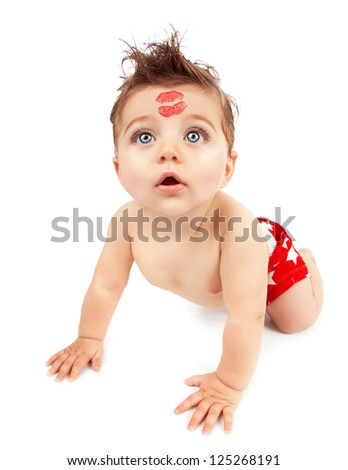 Image of funny baby boy crawling in studio, happy child with red kiss on the forehead isolated on white background, Valentine day, romantic holiday, adorable kid, love and care concept - stock photo