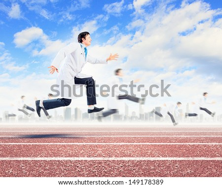 Image of funny doctor running at stadium - stock photo