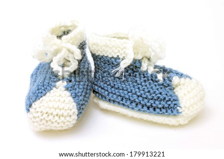 Image of funny little booties as sneakers, close-up - stock photo