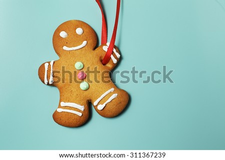 Image of Gingerbread man on green background  with copyspace - stock photo