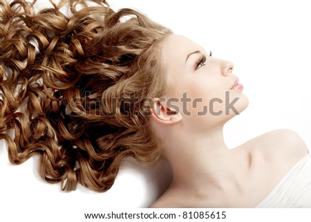 Image of girl with perfect curls - stock photo