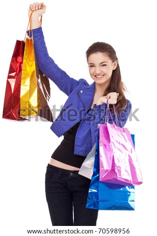 Image of girl with their purchases. Isolated on white background. - stock photo
