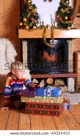 Image of glad boy with Christmas present - stock photo