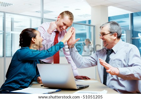 Image of glad businesspeople congratulating each other on corporate victory - stock photo