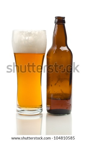 Image of glass and bottle of beer - stock photo
