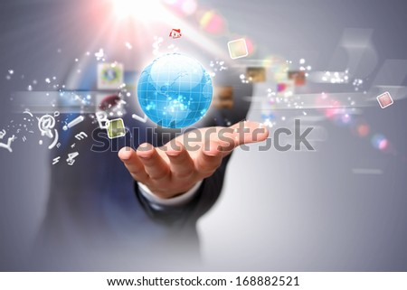 Image of globe on palm of businessman. Media technologies