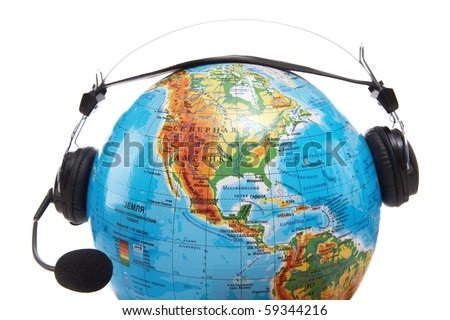 Image of globe with headset on it on white background - stock photo