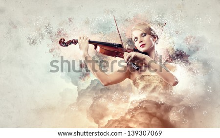 Image of gorgeous woman playing violin against colorful background - stock photo