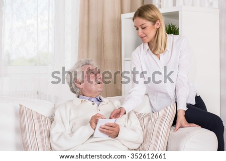 Image of granddaughter with ill old grandfather
