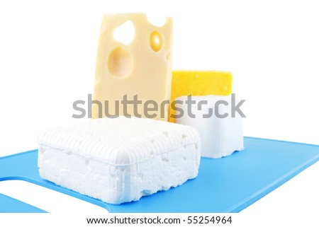 image of greek cheeses on blue plate - stock photo