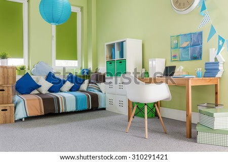 Image of green cosy furnished functional room for child - stock photo