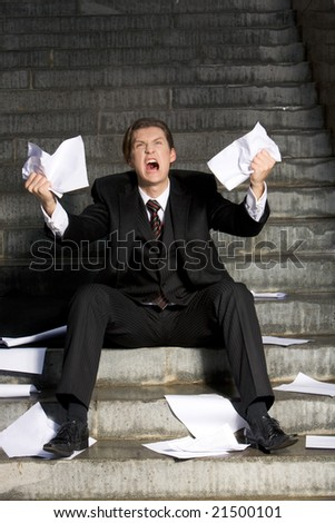 Image of grieving businessman crying with papers in hands - stock photo