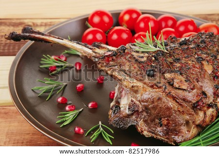 image of grilled ribs served on wooden table - stock photo