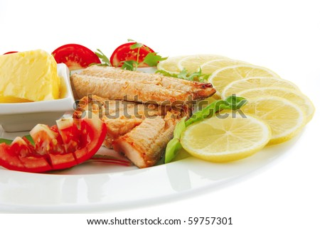 image of grilled salmon with vegetables on white