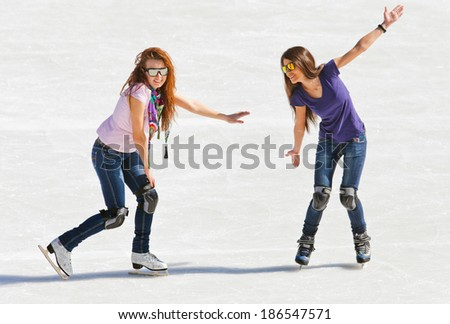 Image of group of teenagers on the ice skating at the Medeo - stock photo