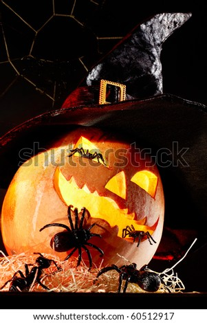Image of Halloween pumpkin in hat with spiders on it - stock photo