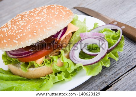 Image of hamburger on wooden background
