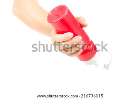 Image of hand hold ketchup bottle isolate on white background - stock photo