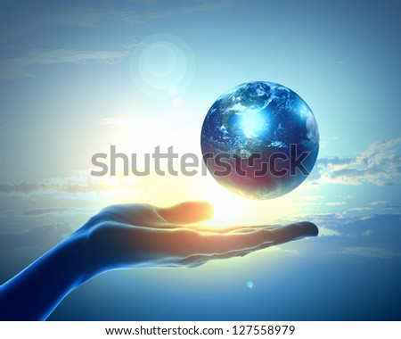 Image of hand holding earth planet against illustration background - stock photo