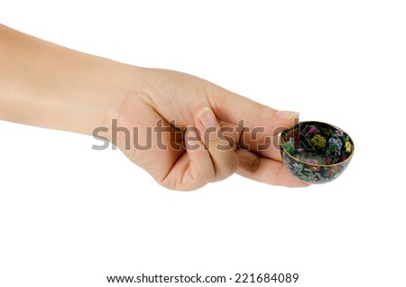 Image of hand with ceramic bowl isolate on white background