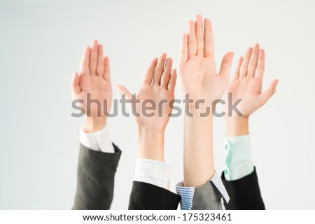 Image of hands voting on the foreground  - stock photo