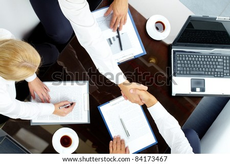 Image of handshake of successful partners after negotiations - stock photo
