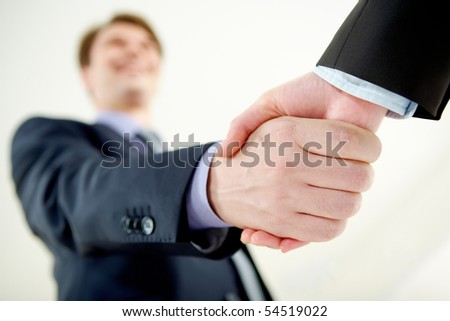 Image of handshaking of business partners on signing agreement - stock photo