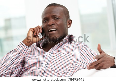 Image of handsome businessman or agent talking by cellular phone - stock photo