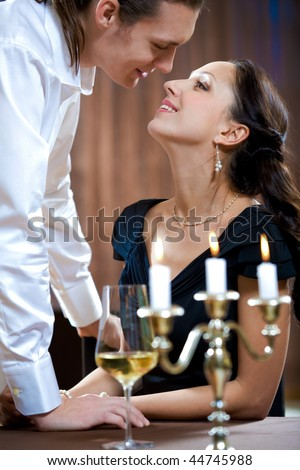 Image of handsome man flirting with beautiful woman - stock photo