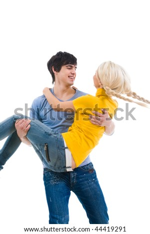 Image of handsome man holding his girlfriend and both laughing