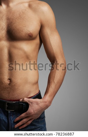 Image of handsome man with bare torso posing before camera - stock photo